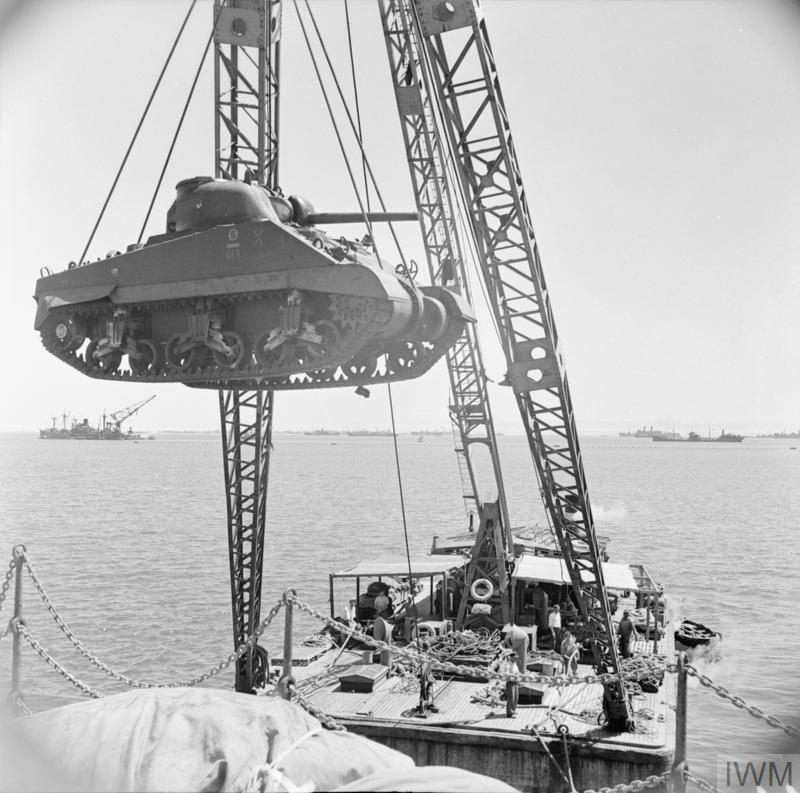 A newly-arrived Sherman tank being loaded onto a 'Z' craft to be taken ashore at Port Tewfik, Egypt, 9 Sep 1942. IWM photo E 16603.