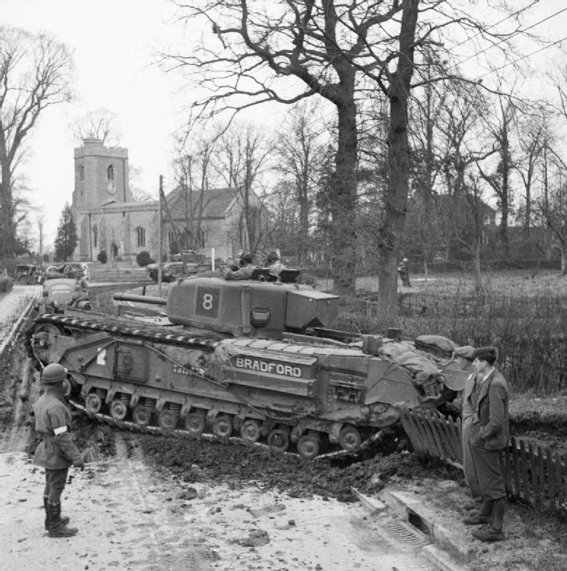 Churchill IV tank enters a village during Exercise 'Spartan', 9 Mar 1943. IWM photo H 27928.