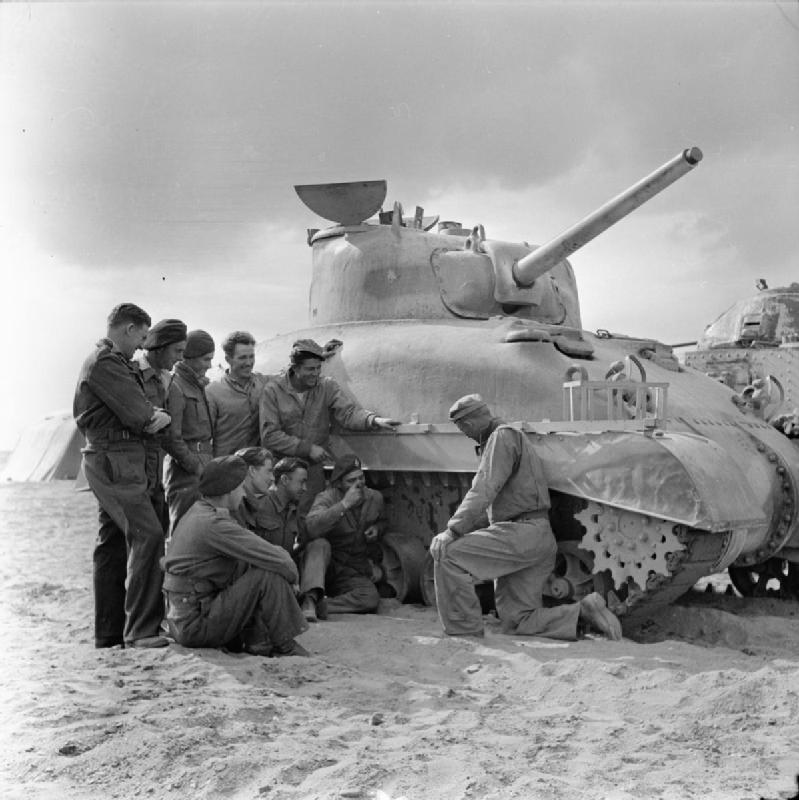 English, South African and New Zealander tank crews receive instruction on the Sherman tank by an American instructor at Dab el Haag training camp near Cairo, 24 Feb 1943. IWM photo E 22596.