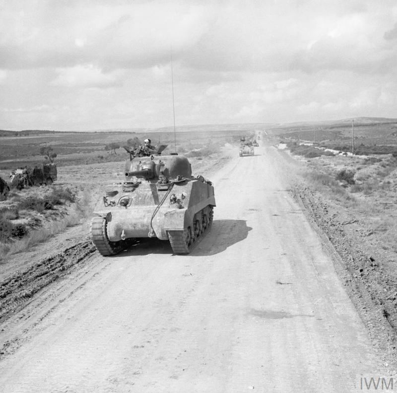 Sherman tanks move up during the advance to Kasserine, 24 Feb 1943. IWM photo NA 847.