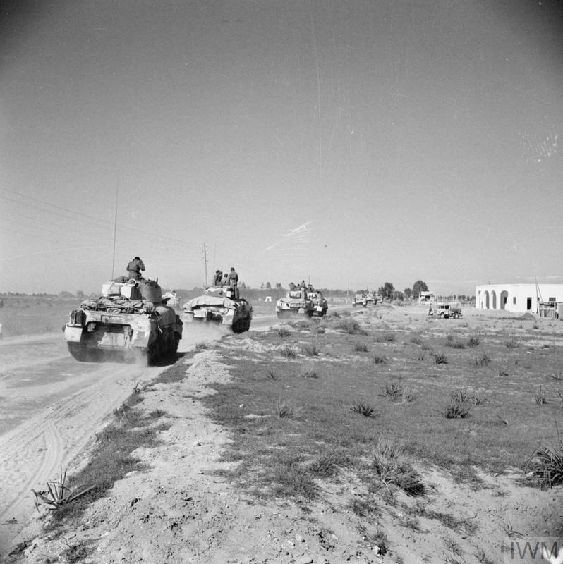 Sherman tanks during the advance along the coast road towards Tripoli, 27 Jan 1943. IWM photo E 21797.
