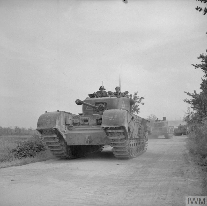 A Churchill tank leads a troop of Sherman flail tanks of 79th Armoured Division during the assault on Boulogne, Sep 1944. A French sailor can be seen manning the radio in the Churchill, guiding the vehicles towards their objective. IWM photo HU 104161.