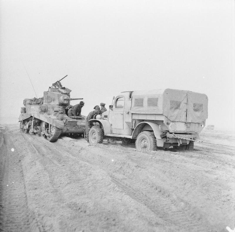A Stuart tank comes to the rescue of a truck which has become stuck in soft sand near Nufilia, 26 Dec 1942. IWM photo E 20485.