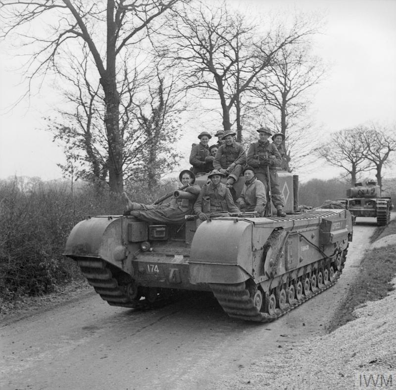Canadian infantry riding on a Churchill III tank during Exercise 'Spartan', 9 Mar 1943. IWM photo H 27924.