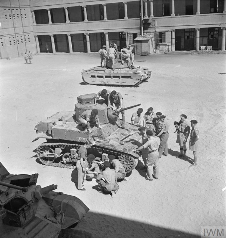 RTR tank crews being introduced to the new American M3 Stuart tank at a training depot in Egypt, 17 Aug 1941. Note the Matilda in the background. IWM photo E 3438E.