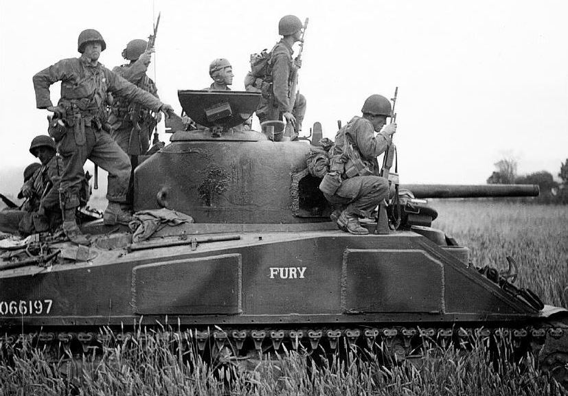 M4 Sherman ''FURY'', F CO., 66th Armored Regiment, transporting 22nd Infantry Regiment soldiers during Operation Cobra.