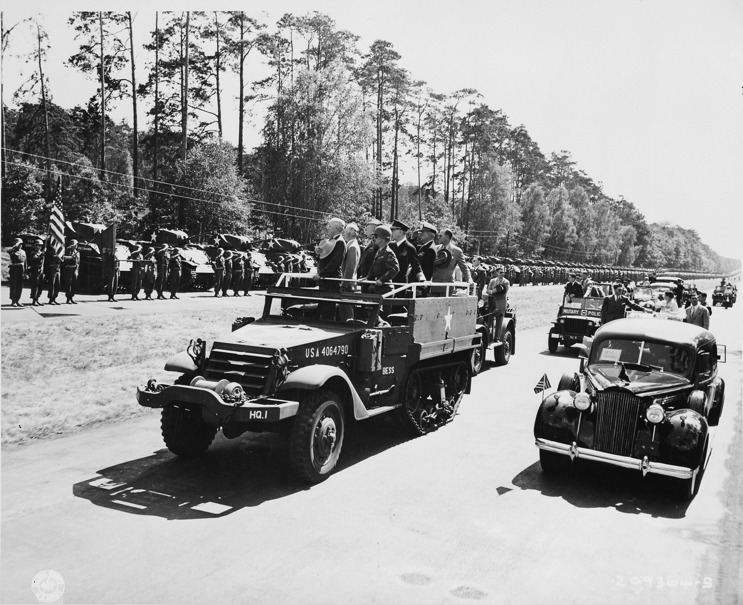 President Harry S. Truman reviews the 2nd Armored Division, deployed along the autobahn leading from Potsdam to Berlin, Germany. President Truman is in this area to attend the Potsdam Conference. 16 July 1945. NARA photo # 198766