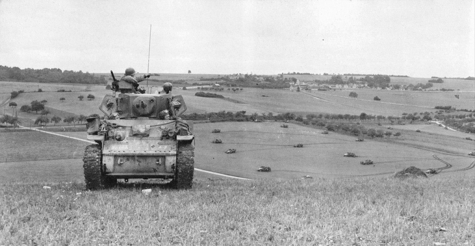 66th ARM RGT M5A1 Stuart providing overwatch of a mechanised infantry company near Buchet, France, 31 Aug 1944.