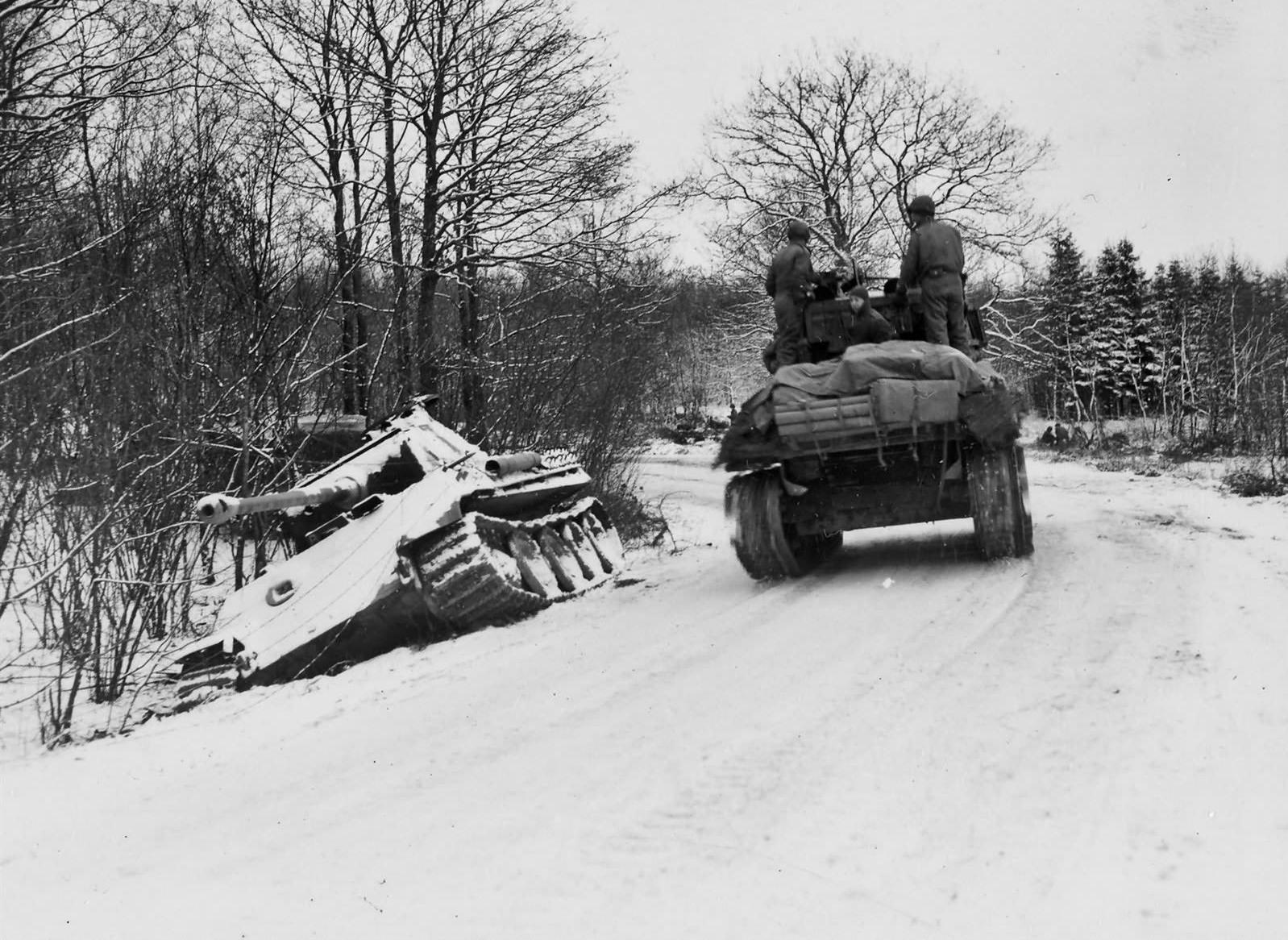 2AD Sherman passes a German Panther tank, Grandmenil, Belgium.