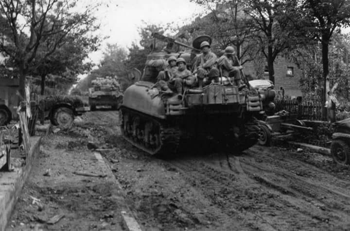 67th ARM RGT M4A1's with troops of the 116th INF RGT, 29th ID in Ubach, Germany. 1 Oct 1944