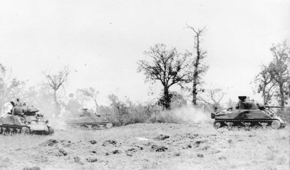 F CO, 66th ARM RGT Shermans fan out during Operation Cobra. ''Falcon'' is the lead tank.