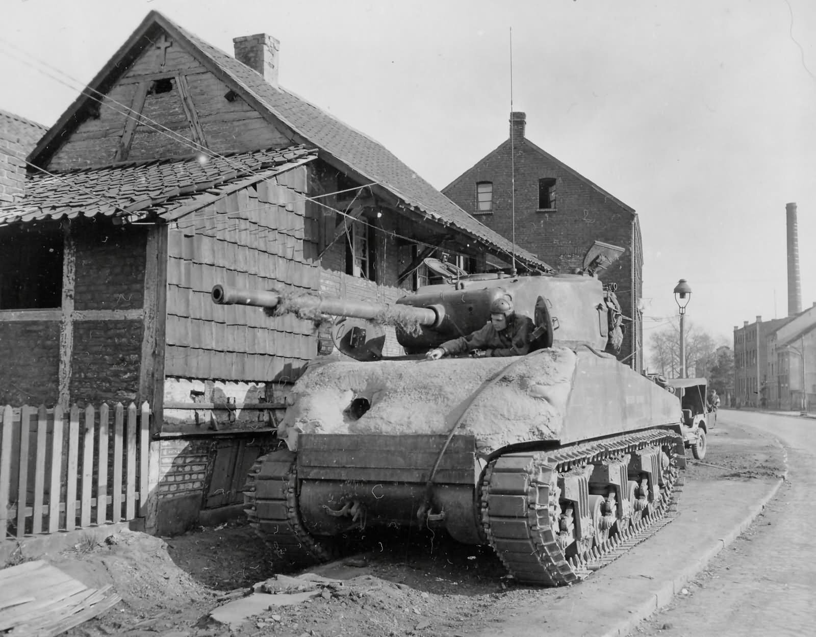 2AD M4 (76) Sherman with concrete armor. Gelsenkirchen, Germany. 19 Mar 1945