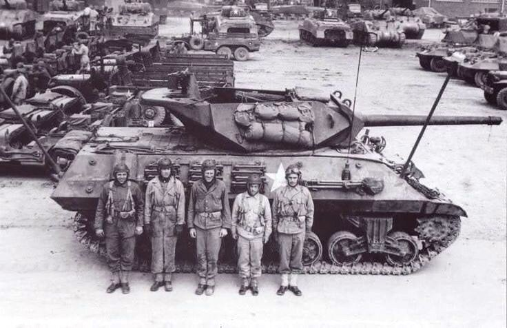 """Crew of M10 GMC """"Bouncing TNT"""", B CO, 803rd Tank Destroyer BN, at a depot in Cornwall, England. The Battalion was attached to 2AD. Apr 1944."""