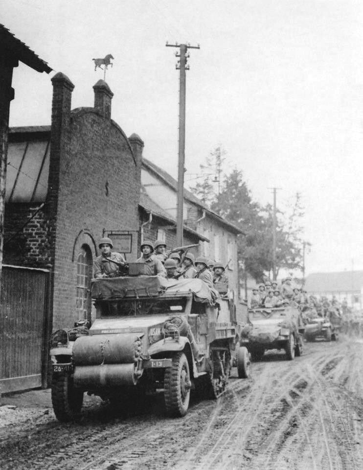 I CO, 41st AIB, halftracks enter Jüchen, Germany, 28 Feb 1945