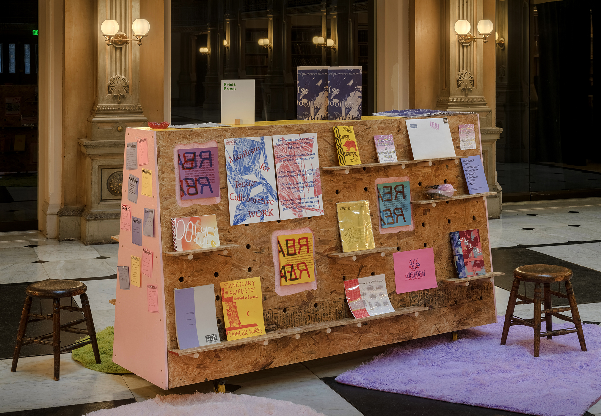 wooden mobile cart displaying Press Press publication archive at George Peabody Library