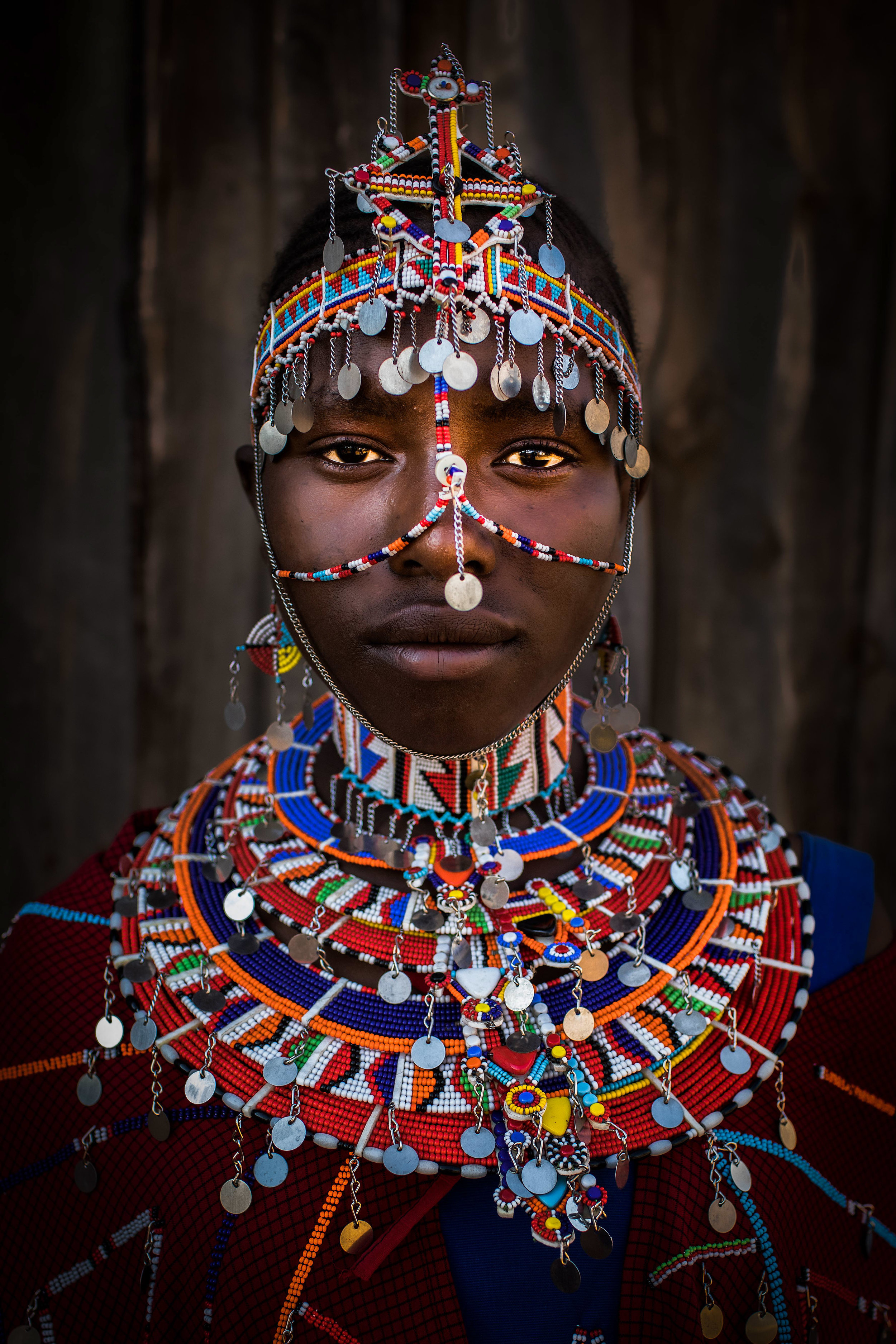 Growing up Female in Maasai Society from the series A Centuries Old Maasai Custom: Female Genital Mutilation: Makuta, Kenya. The series aims to advocate for and alongside survivors of female genital mutilation. Growing up Female in Maasai Society has been awarded 2019 International Color Awards in the category Portrait; 2018 Lucie Foundation International Photography Award | 1st Event/ Social Cause category + Honorable Mention for Culture and Traditions category. Finalists were selected from approximately 16,000 submissions (38,000 images) from over 130 countries.