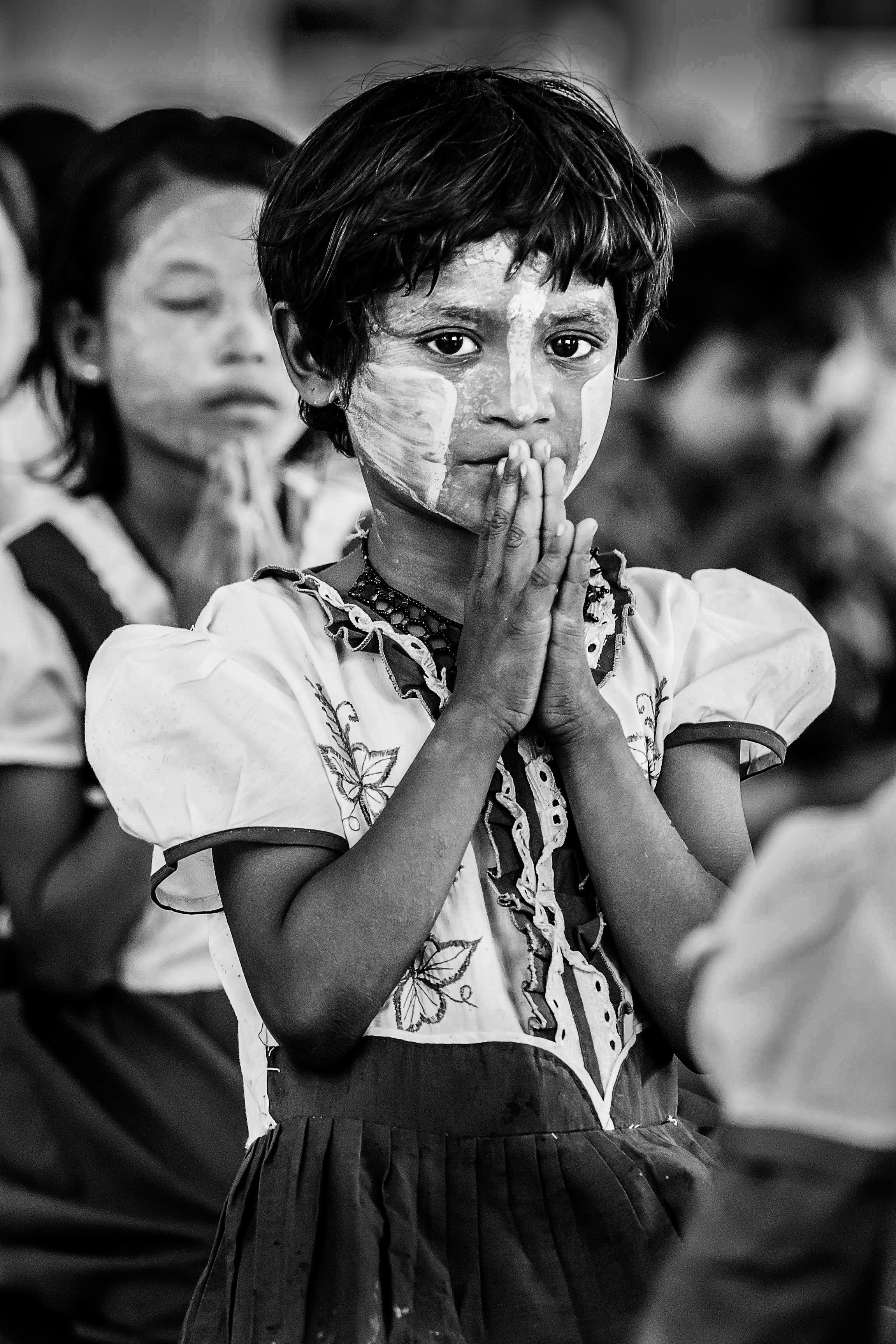 Female student during Prayers at the Alaikyanug Pariyatti Monastic Education School, Alikyaung Dalla Township, Yangon, Myanmar
