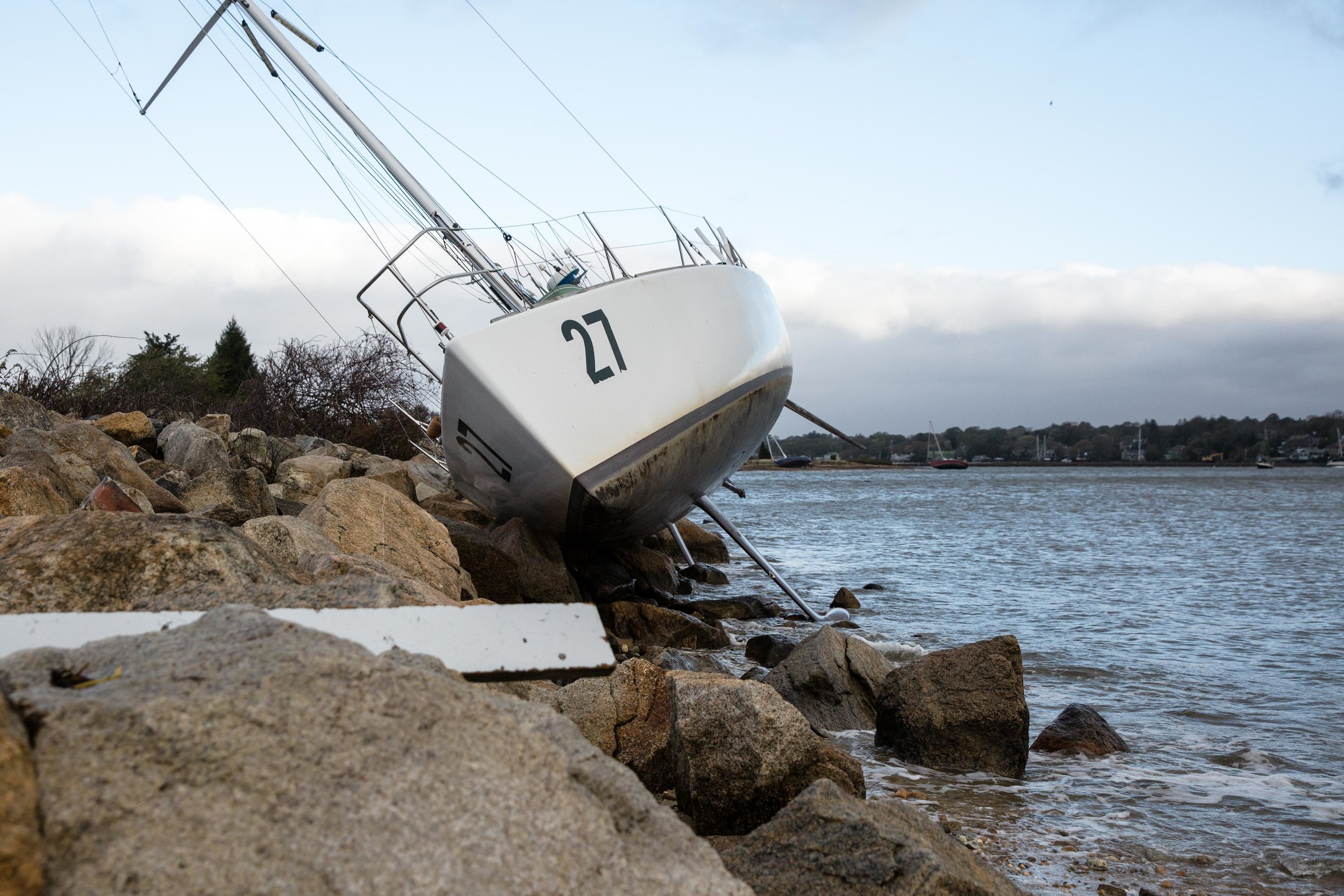 A sailboat rests on the rocks near Smithneck Road.