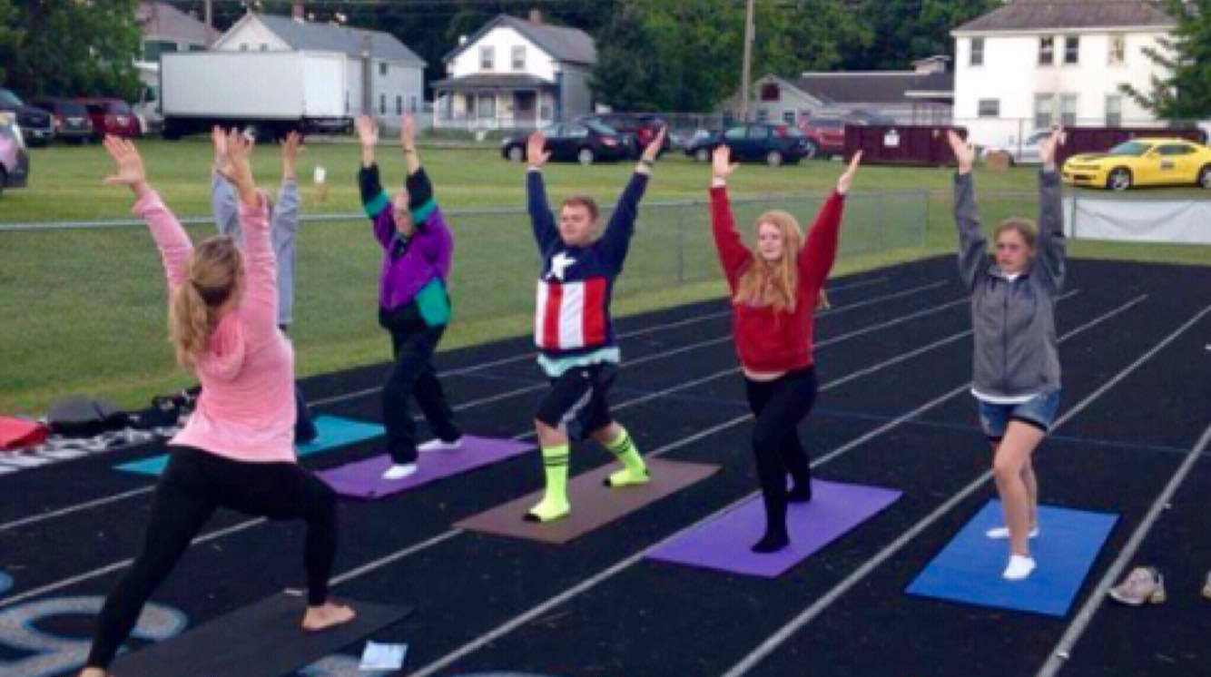 Jeannie leads 'Yoga For Students' out on the track