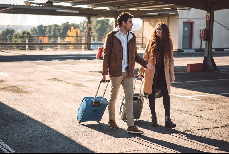 2314753-couple-walking-and-talking-with-luggage-woman-photocase-stock-photo-large.jpeg