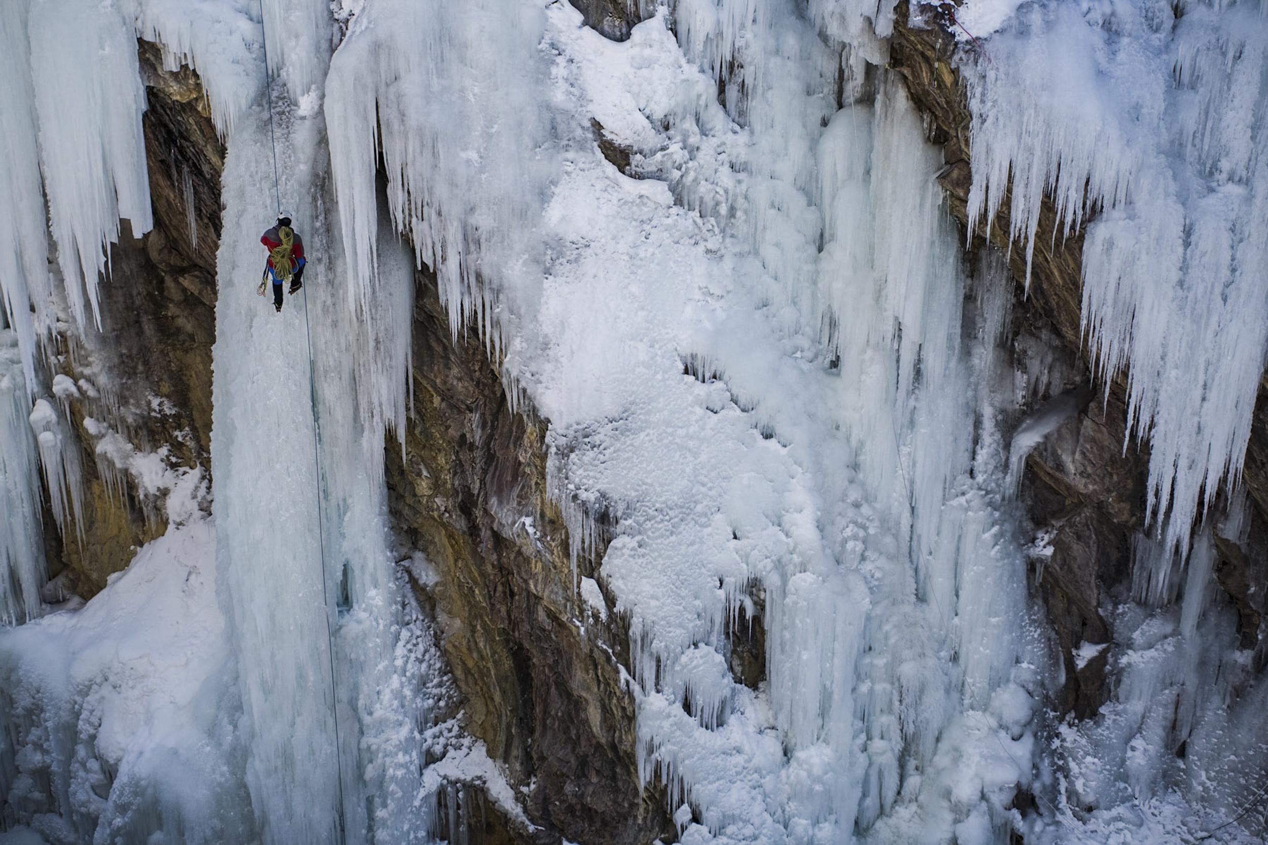 Climber repelling into a canyon Ouray, Colorado
