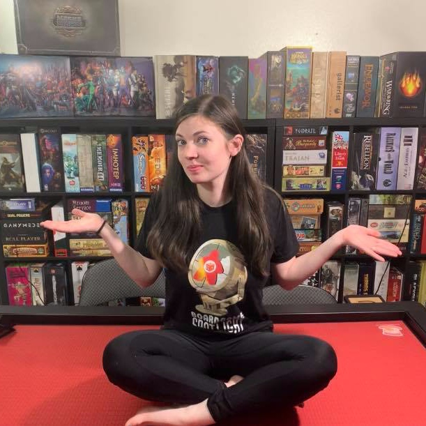 Join Lizzy Funkhouser! - Lizzy loves all games, especially roll & writes! She runs The Board Game Spotlight Facebook group where she creates content and livestream games with her husband, Derek. She is also the mother of Seb(zilla) who is a gamer in the making.