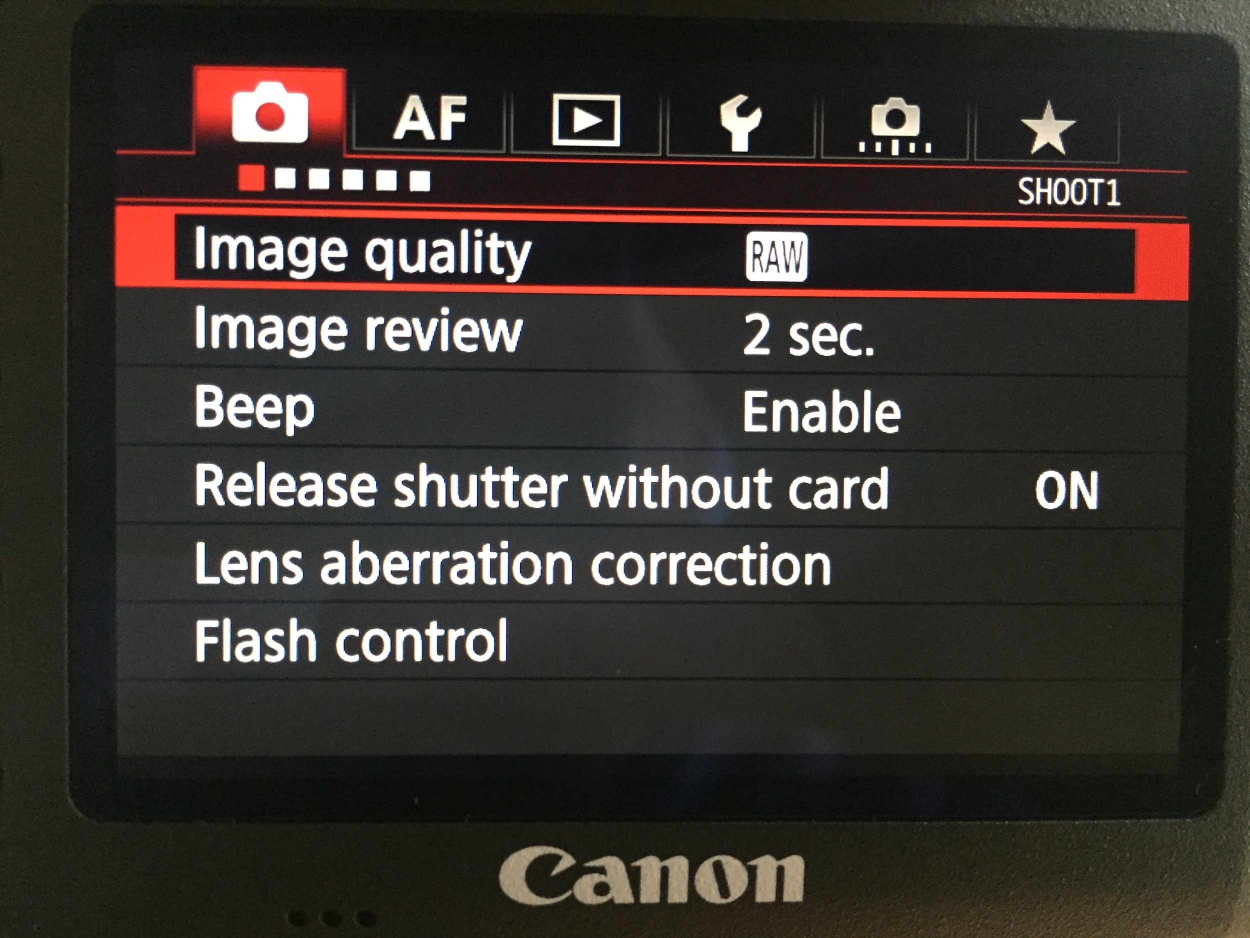 """Menu of a Canon camera. Six tabs that each have a few """"pages"""" with different settings and options."""