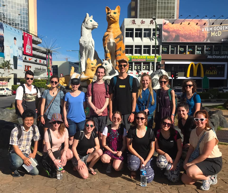 Deakin Envrio students stand in frot of the famu=ous 'Cat statue' of kuching