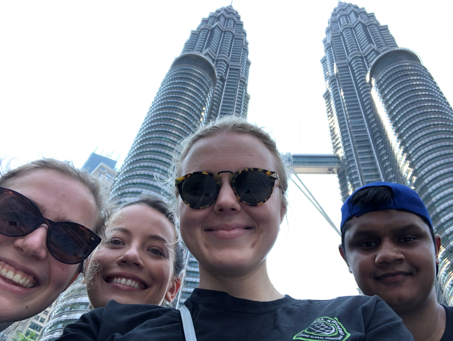 Deakin PR & COmms students take an iconic pic in front of the petronas twin towers