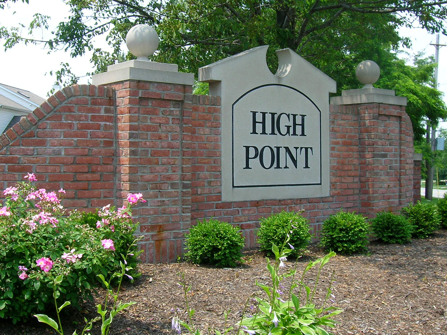 Brick and masonry entrance signs greet visitors entering the development.