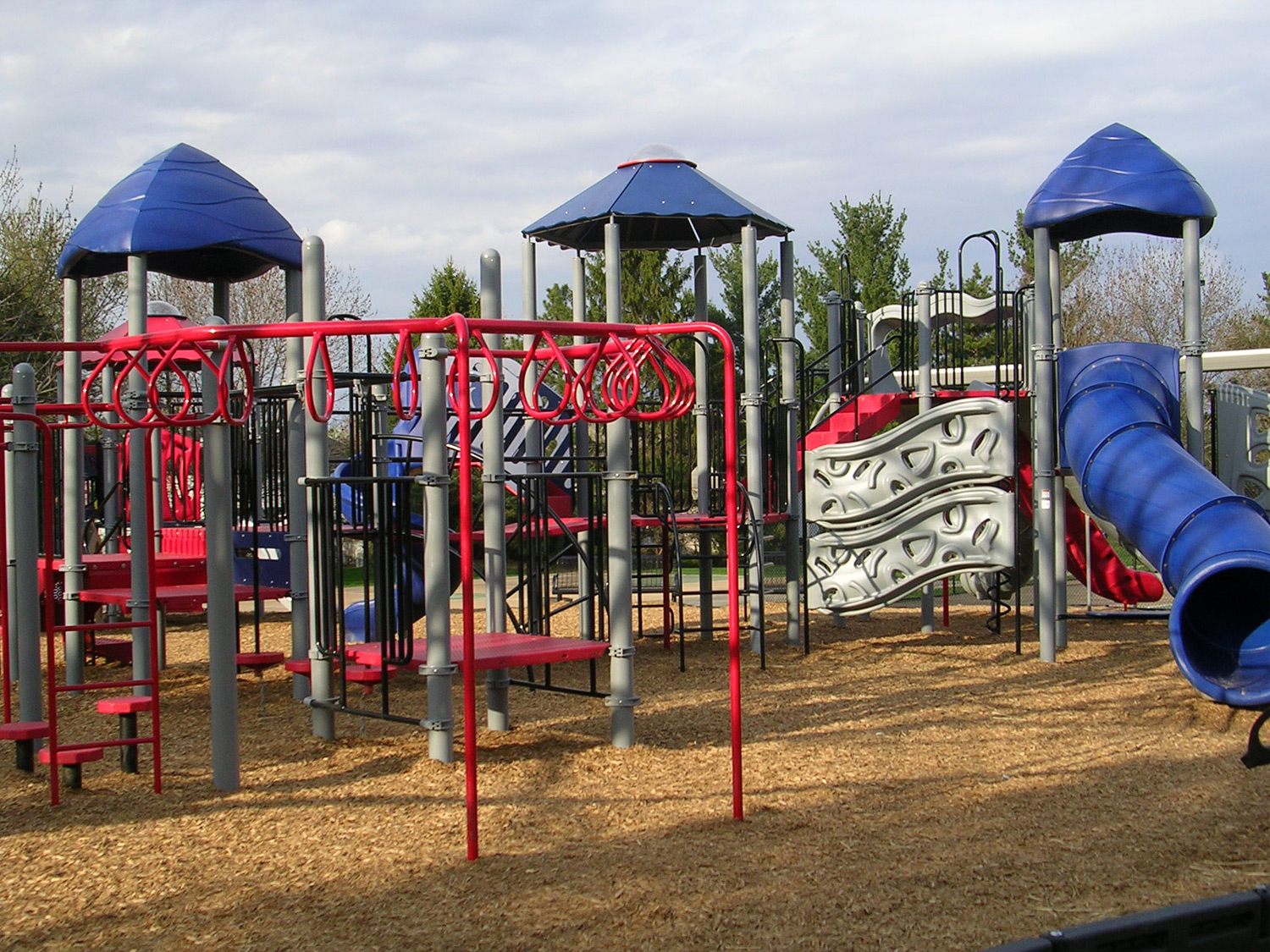 A favorite part of the playground is the climbing area where many different options for overhead activity can be found.