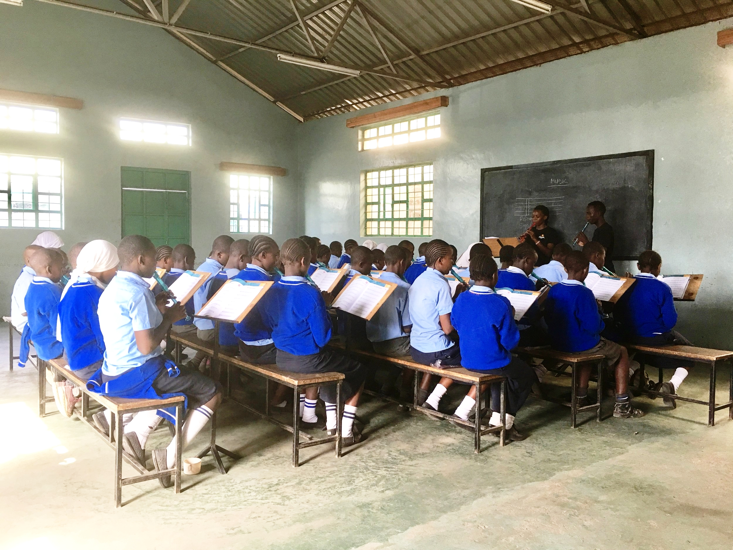 Music class in Korogocho Nairobi. All the students learn how to play the recorder, sight read and music theory.