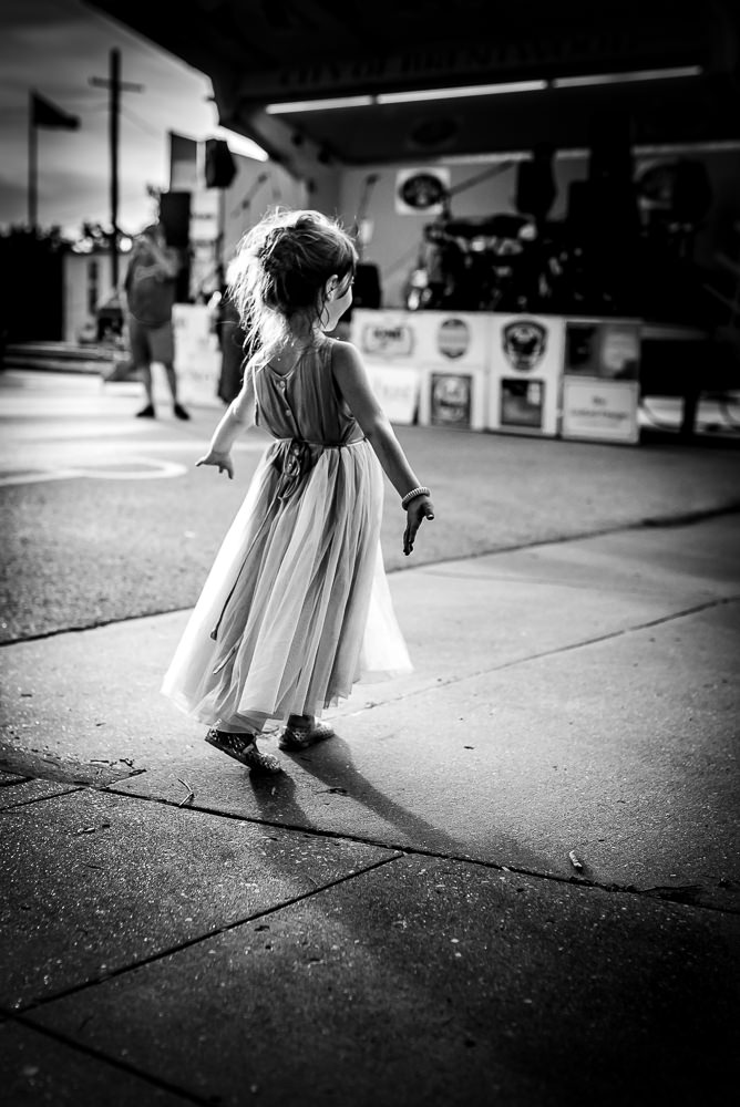 little girl dancing at a local music festival in Webster Groves, MO.jpg
