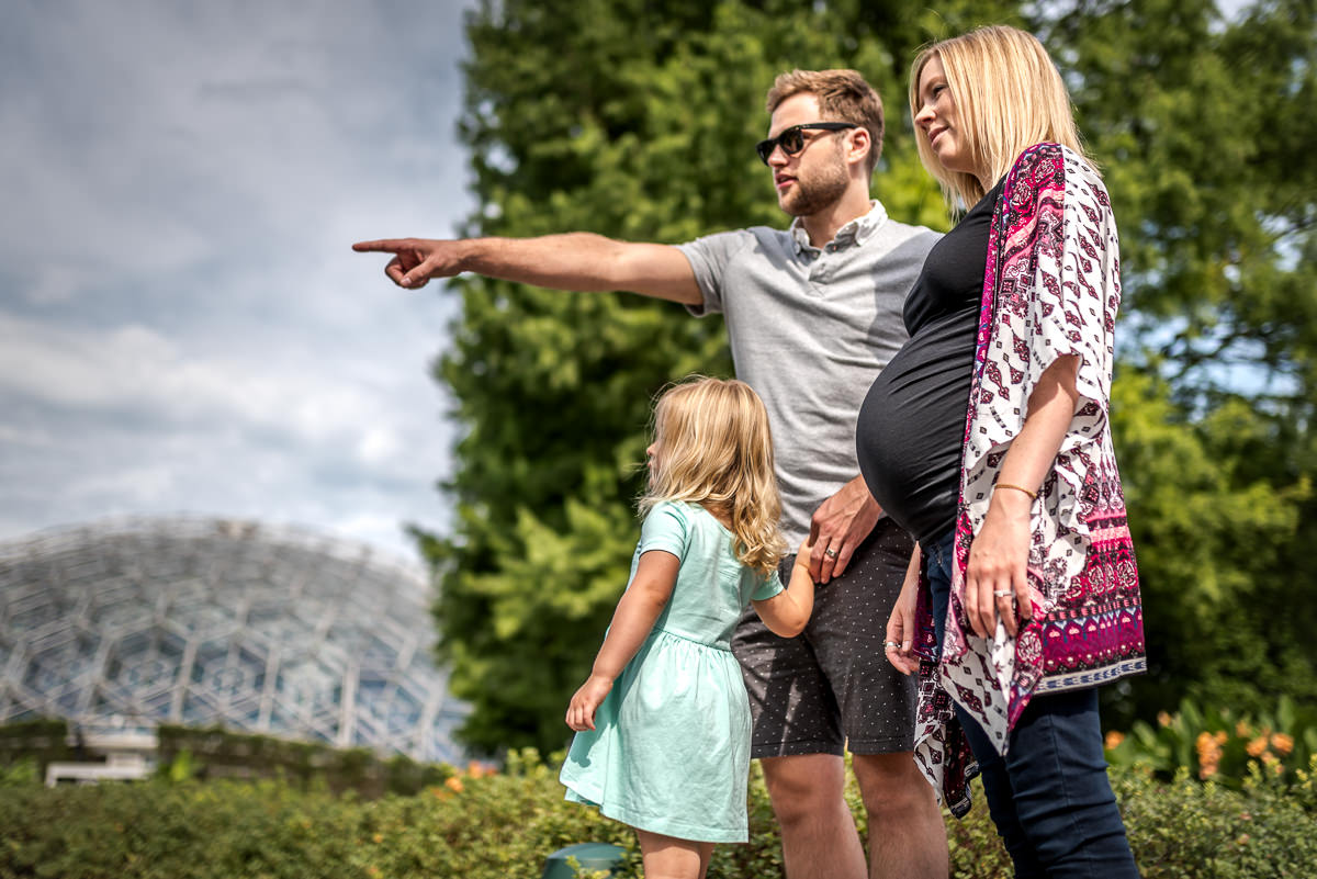 Fun family of three enjoys a day in St. Louis at the Missouri Botanical Garden before baby comes