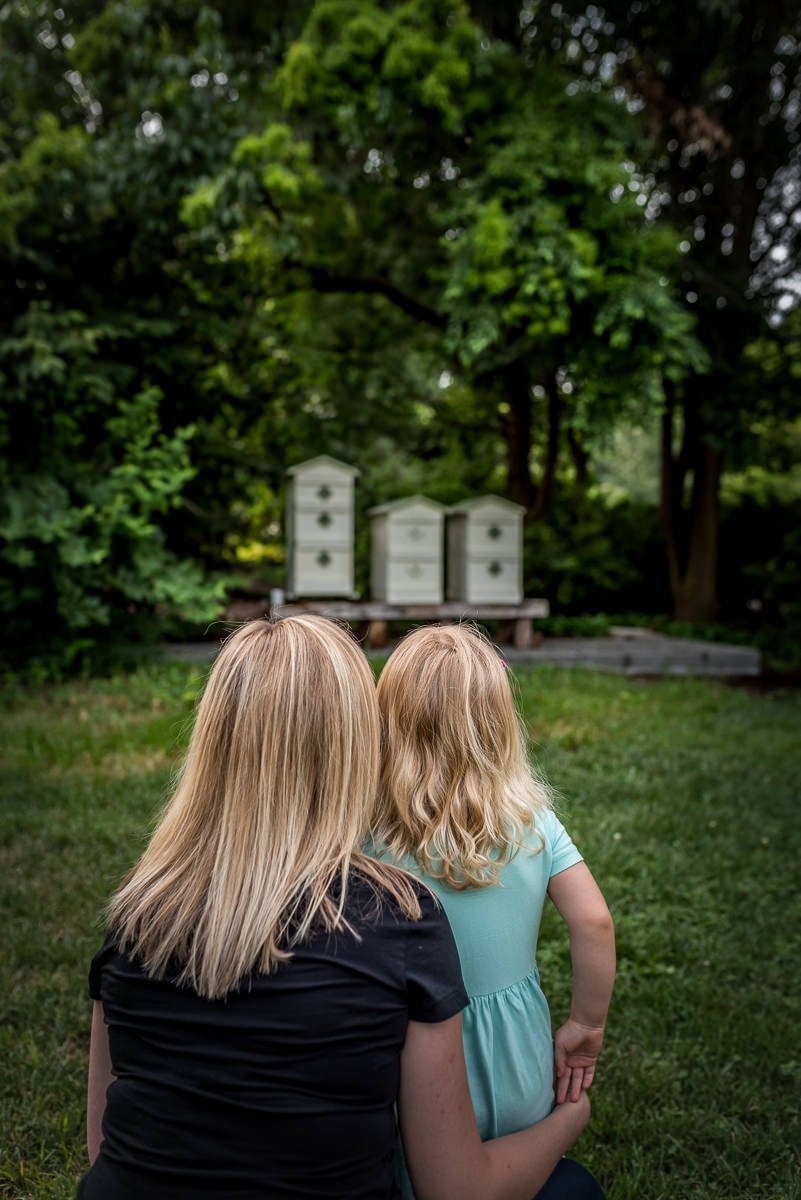 Mom and daugter observing the bee boxes during a day trip to MoBot in St. Louis.
