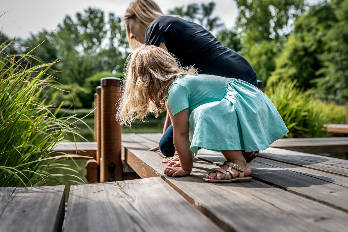 mother and daughter look for fish during a photo session in St. Louis