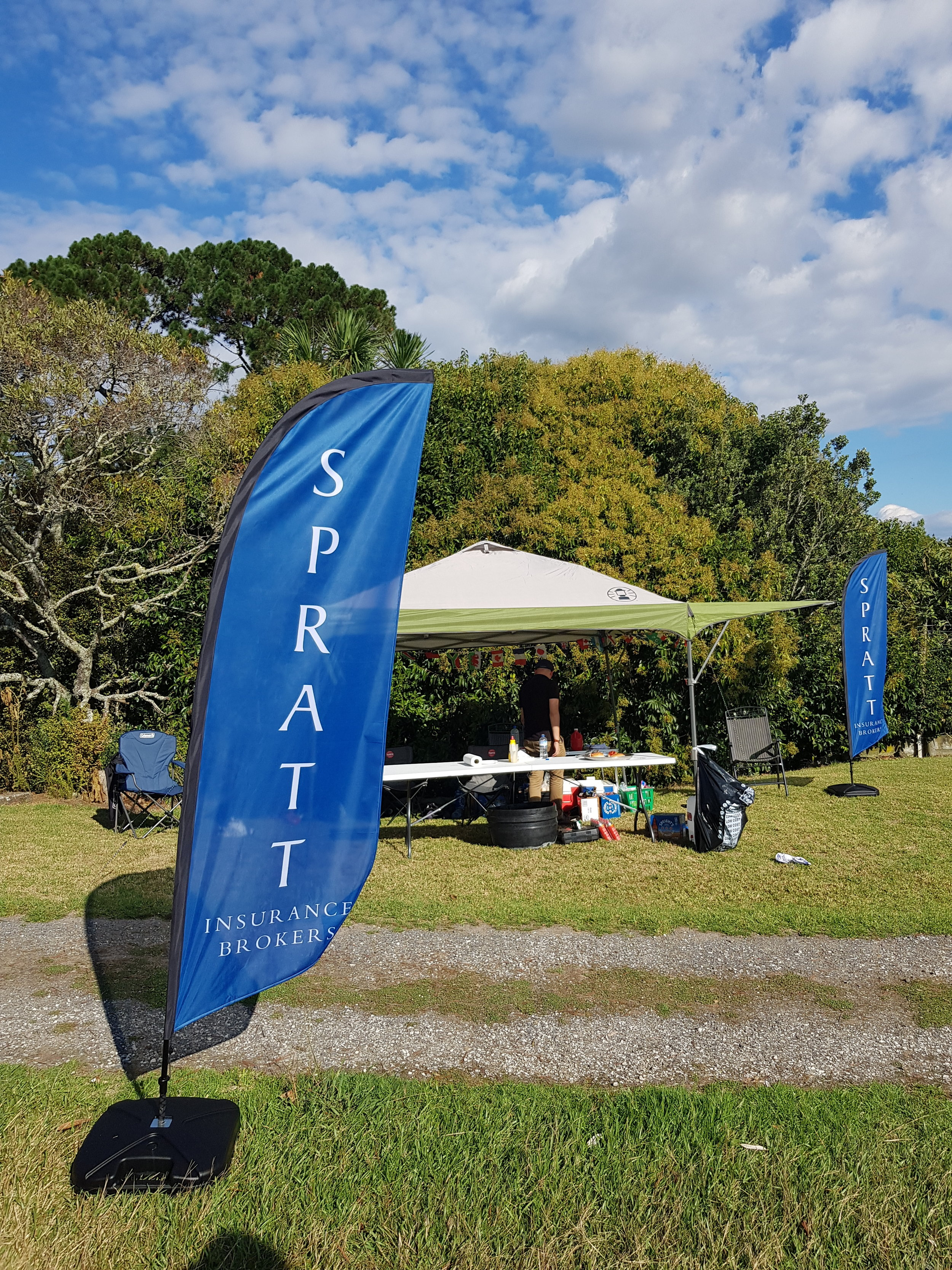 Spratt Insurance Brokers banner displayed at the Henderson Rotary Golf Day.