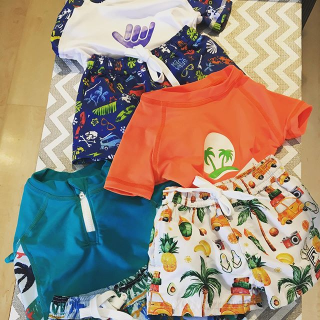 Your baby boy will look so cool in our new rash guards and swim bottoms!!
