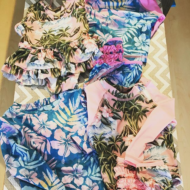 We have new baby rash guards (with zippers to help get it over their sweet little head) with matching bottoms and swimsuits!! Come in before you head down to the beach