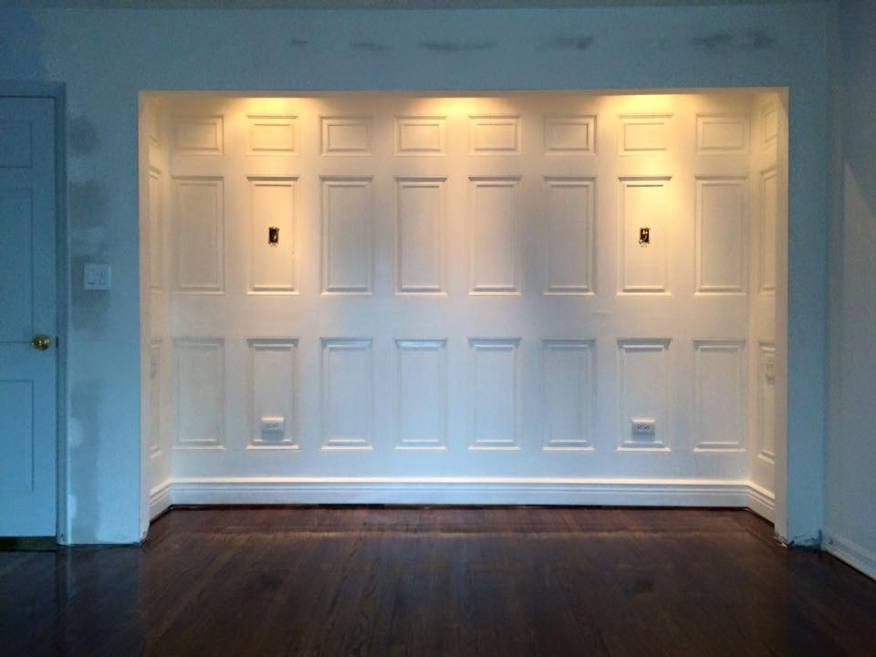 Custom headboard nook in master bedroom made from salvaged doors.