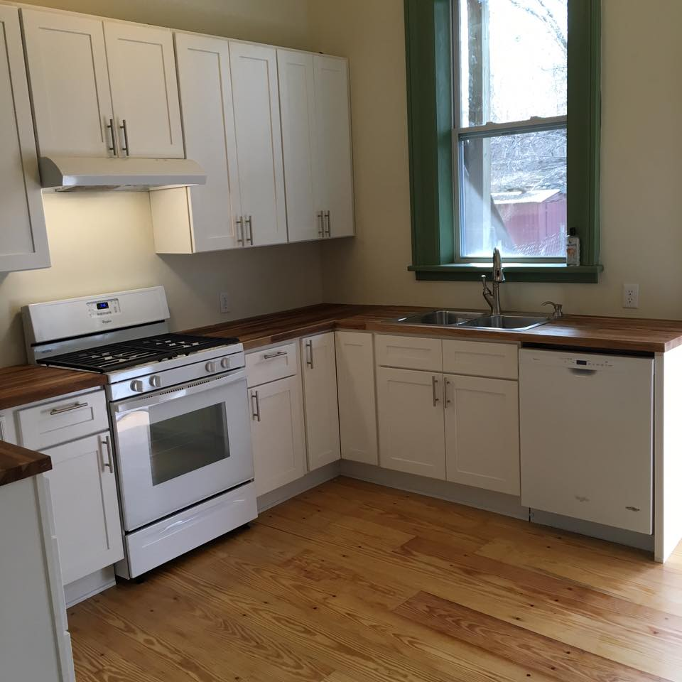 Kitchen renovation in Albany's historic mansion district. Salvaged, refilled yellow pine flooring, shaker style hardwood cabinets and butcher block counters. Clean, warm and inviting!