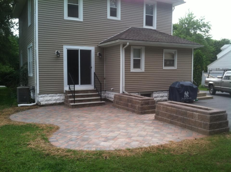 New patio with sliding door, stairs and custom planters.