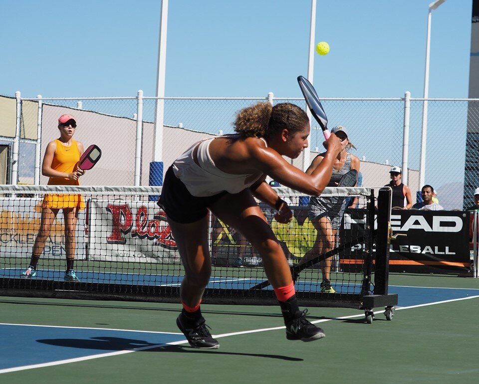 Jessie Irvine chasing down a shot from Leigh Waters. Courtesy ProPickleball.