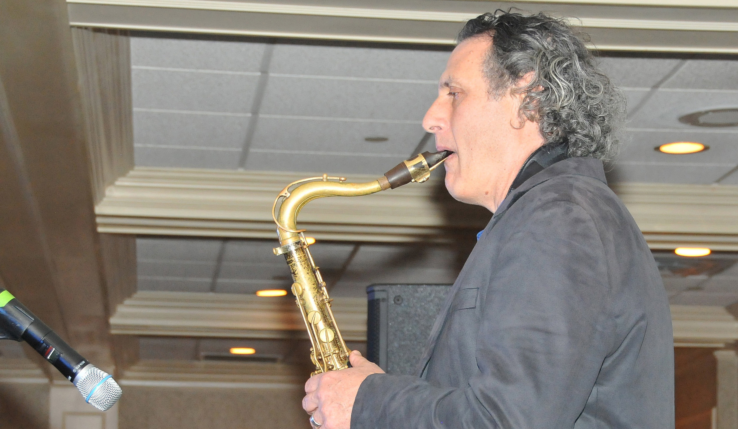 Sax player on stage w Ben Sampson n Girl in background.jpg