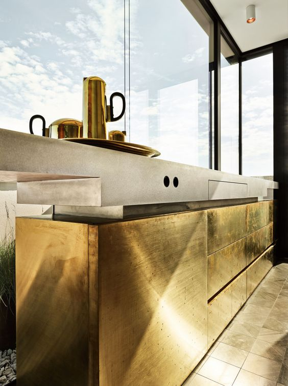 A minimalist leo? (do those exist??) Step up your game with  highly textured gold cabinetry.