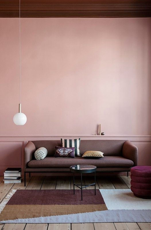 Soft blush pink walls with a faint texture create interest without cluttering. And I'm a sucker for a single,  minimal pendant  in lieu of a lamp!