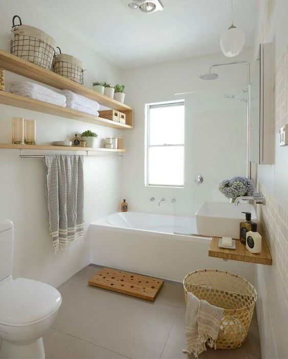A clean bathroom, with everything open, airy and accessible.
