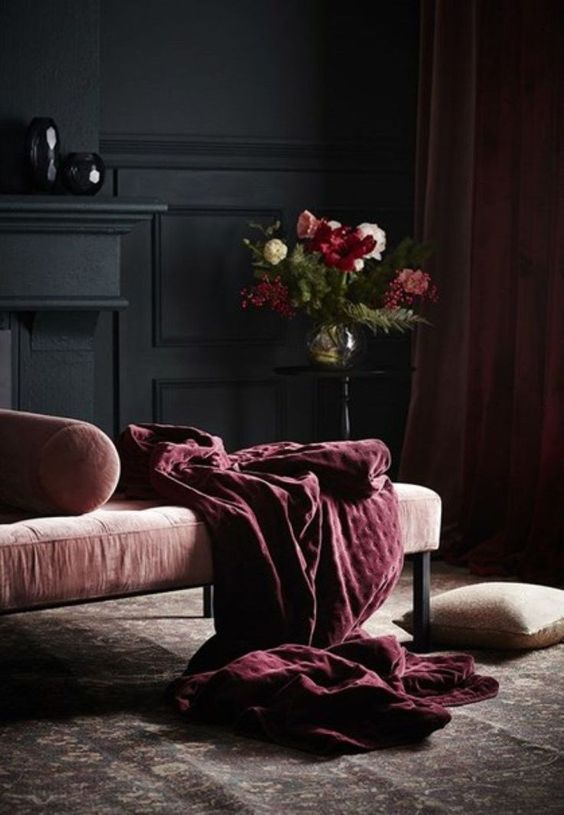 A dark  interior , with a comfortable chaise for reading.