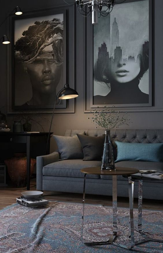 Dark, abstract photography create a sense of comfortable disconnect in this dark living room.