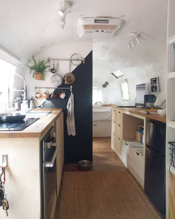 A tiny, yet airy kitchen in a small  mobile home .